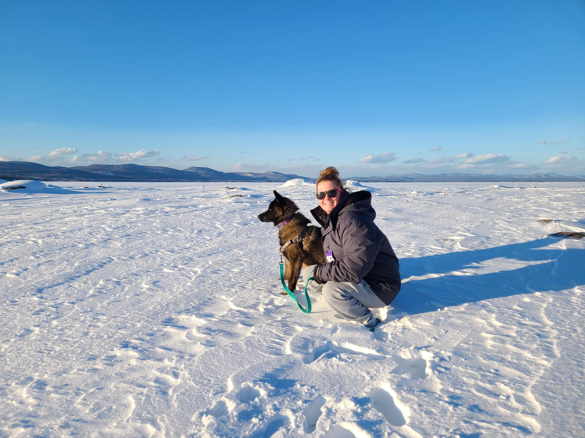 Woman with a dog on a field of ice