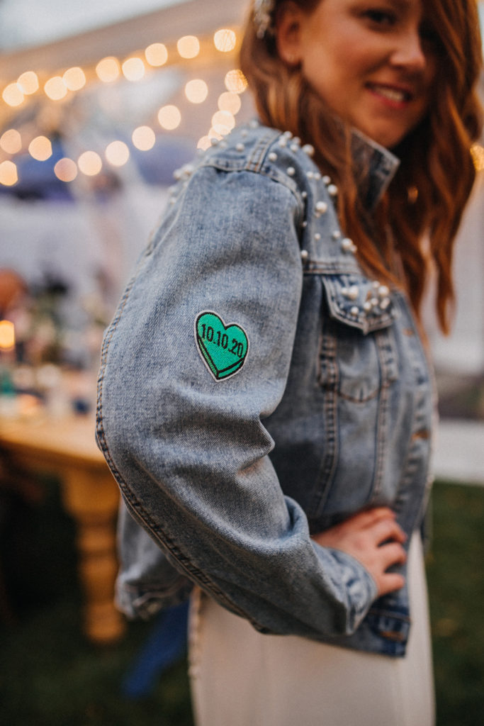 A shallow depth-of-field photograph of a woman in a jean jacket